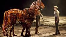 "A scene from the theatre production of ""War Horse"" is shown in a handout photo. (Brinkhoff/Moegenburg/THE CANADIAN PRESS)"