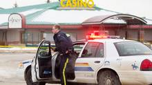 An RCMP officer guards the scene where two officers were shot at the APEX Casino in St. Albert, Alta., on Jan. 17. (Amber Bracken For The Globe and Mail)