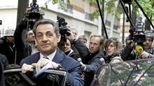 French President and UMP party candidate for France's presidency Nicolas Sarkozy prepares to enter a car as he leaves his campaign headquarters the morning after the first round of voting in Paris, Monday, April 23, 2012. French Socialist Francois Hollande came first in Sunday's initial round of voting. (Laurent Cipriani/AP/Laurent Cipriani/AP)