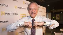 "Postmedia president and CEO Paul Godfrey shows off his ""Sun"" cufflinks on March 25, 2015. (Mark Blinch for The Globe and Mail)"