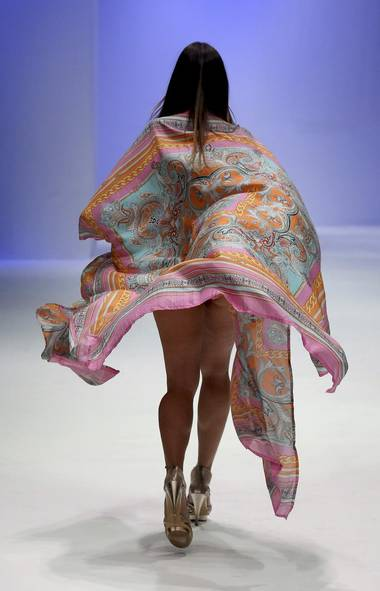 A model presents a creation by Silvian Imberg at Women's Fashion Week in Singapore.