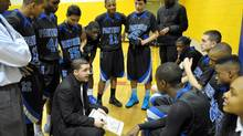 St. Marguerite d'Youville Secondary School Panthers teachers and basketball coaches Dexter McDonald, left, and Mike Mackenzie, lower, read out a play during a timeout during a game against the Ascension of Our Lord Eagles in Mississauga, January 8, 2013. Some students are leaving public boards and headed to separate school boards in search of sports and other extra cirriculars. (J.P. MOCZULSKI)