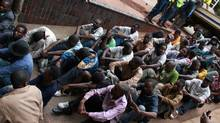 """A group of 46 social and human rights activists appear in court in Harare, Wednesday, Feb. 23, 2011. The group led by Munyaradzi Gwisai is alleged to have organized a meeting where they played video footage of the Egypt uprising allegedly """"to inspire and motivate people to demonstrate against the government"""". Police say attendees called for solidarity with Egyptian and Tunisian workers and intended to incite Zimbabweans to hold demonstrations against three decades of authoritarian rule by President Robert Mugabe (Tsvangirayi Mukwazhi/Tsvangirayi Mukwazhi/The Associated Press)"""