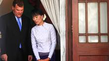 Myanmar's pro-democracy leader Aung San Suu Kyi and Canada's Foreign Minister John Baird exit Suu Kyi's home after their meeting in Yangon. (Soe Zeya Tun/Reuters)