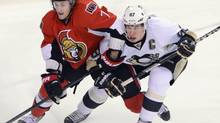 Ottawa Senators' Kyle Turris, left, pushes back as Pittsburgh Penguins' Sidney Crosby defends in front of the net during first period NHL hockey action at the Scotia Bank Place in Ottawa on Sunday, Jan. 27, 2013. (Sean Kilpatrick/THE CANADIAN PRESS)