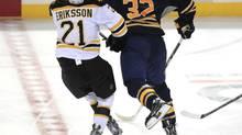 Buffalo's John Scott faces a league hearing Thursday for this head shot on Boston's Loui Eriksson. (Harry Scull Jr./AP)