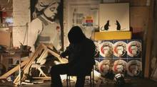 "Banksy seen in an interview from the film ""Exit Through the Gift Shop"" (Courtesy of Mongrel Media)"