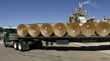 A truck loaded with rolls of newly produced paper. (Damian Dovarganes/Damian Dovarganes/AP)