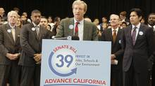 Billionaire Tom Steyer, the chief financier behind the Proposition 39 campaign, discusses a proposed bill to fund energy efficiency projects at schools in California's poorest communities, during a news conference at Mark Twin Elementary School in Sacramento, Calif., on Dec. 4, 2012. (Rich Pedroncelli/AP)