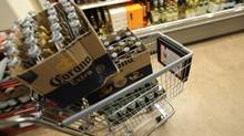 A customer buys beer at an LCBO in Toronto on Dec. 14, 2012. (FRED LUM/THE GLOBE AND MAIL)