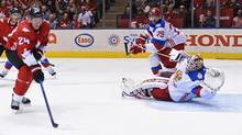 Team Canada's Corey Perry (24) scores against Team Russia's goalie Sergei Bobrovsky (72) as Russia's Andrei Markov (79) defends during third period World Cup of Hockey semifinal action in Toronto on Saturday, September 24, 2016. (Nathan Denette/THE CANADIAN PRESS)