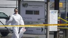 RCMP investigators on the scene at the Western Forest Products mill where two people are confirmed dead, two injured in Nanaimo sawmill shooting. (John Lehmann/The Globe and Mail)