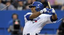 Toronto Blue Jays batter Edwin Encarnacion breaks his bat on a ground out against the Seattle Mariners during the first inning of their MLB American League baseball in Toronto September 13, 2012. (Reuters)