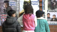 Children look at posters on human rights abuses in North Korea, Feb. 5, 2006, on display at the Full Gospel Inchon Church in Inchon, South Korea. In South Korea, the issue of human rights in the North has been spearheaded by conservative Christian whose aim is to take their faith to the northern half of the divided peninsula. Although the movement's most visible spokesmen are North Korean defectors, its core is made up of South Korean Christians who, in the past decade, have grown into the world's second-largest overseas missionary force after the United States'. (Seokyong Lee/NYT)