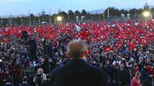 Turkey's President Recep Tayyip Erdogan delivers a speech during a rally a day after the referendum, outside the Presidential Palace, in Ankara, Turkey, on Monday. (AP)