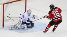 New Jersey Devils center Jacob Josefson (16) scores against Toronto Maple Leafs goalie Jhonas Enroth (35) during the shot out at Prudential Center. The Devils won, 5-4 in a shoot out. (Vincent Carchietta/USA Today Sports)