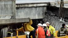 An inspection teams examines a collapsed overpass in Montreal on in October, 2006. A leaked government report has found widespread corruption in Quebec construction contracts. (Ian Barrett/CP)