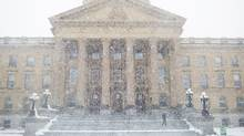 A man leave the Alberta Legislature on a snowy spring day in Edmonton, Alta., on May 6, 2015. (AMBER BRACKEN For The Globe and Mail)
