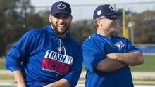 Toronto Blue Jays starting pitcher Marco Estrada, left, laughs with manager John Gibbons, right, during spring training in Dunedin, Fla., on Feb. 15. (Nathan Denette/THE CANADIAN PRESS)