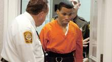 Lee Boyd Malvo enters a courtroom in Spotsylvania, Va., on Oct. 26, 2004. (MIKE MORONES/Associated Press)