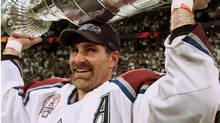 Colorado Avalanche defenceman Ray Bourque lifts the Stanley Cup after defeating the New Jersey Devils 3-1 to win the series four games to three in Denver on Saturday June 9, 2001. (RYAN REMIORZ/Canadian Press)