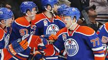 Oilers defenceman Oscar Klefbom celebrates with teammates on the bench after scoring a goal in the third period. (Perry Nelson/USA Today Sports)