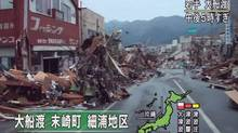 In this image made off Japan's NHK television, debris of houses are left along a street in Ofunato, Iwate Prefecture, northern Japan, Friday, March 11, 2011 after a powerful tsunami spawned by the largest earthquake in Japan's recorded history slammed the eastern coast. Japanese reads: Whole towns of Matsuzaki and Hosoura are swept away in Ofunato (AP Photo/NHK TV)