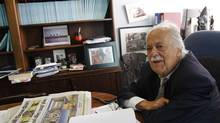 George Bizos, the renowned human rights lawyer, is surrounded by old photos of his late friend Nelson Mandela and other memorabilia at his office in downtown Johannesburg, South Africa. (Erin Conway Smith for The Globe and Mail)