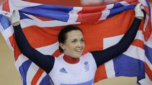 Britain's Victoria Pendleton celebrates after winning the gold in the track cycling women's keirin event, during the 2012 Summer Olympics in London, Friday, Aug. 3, 2012. Pendleton washed away the disappointment of her disqualification in the team sprint by claiming the gold medal in the keirin on Friday at the Olympics. (Christophe Ena/AP)