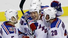 New York Rangers' Rusian Fedotenko, center, is joined by teammates after scoring in the second period of an NHL hockey game, Sunday, April 3, 2011, in Philadelphia. The Rangers defeated the Philadelphia Flyers 3-2 in a shootout. (AP Photo/Tom Mihalek) (Tom Mihalek/AP2011)