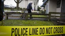 A member of the forensic identification team of the Vancouver Police Department makes his way into a home in March 2011. (JOHN LEHMANN/John Lehmann/The Globe and Mail)