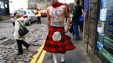 James Wallace wears a kilt as he stands outside the entrance to Edinburgh castle in Scotland, in this January 25, 2012 file picture.QUEBEC-SCOTLAND REUTERS/David Moir/Files (BRITAIN - Tags: POLITICS) (DAVID MOIR/REUTERS)