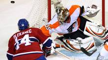 Montreal Canadiens center Tomas Plekanec (14) is stopped by Philadelphia Flyers goalie Sergei Bobrovsky (35) during first period National Hockey League action Thursday, December 15, 2011 in Montreal. (Ryan Remiorz/THE CANADIAN PRESS)