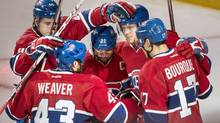 Montreal Canadiens' Lars Eller (81) celebrates with teammates Brian Gionta (21), Rene Bourque (17), Mike Weaver (43) and Nathan Beaulieu (40) after scoring the first goal against the Boston Bruins during first period NHL playoff hockey action on Monday, May 12, 2014 in Montreal. (Paul Chiasson/THE CANADIAN PRESS)