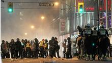 Riot officers some on foot and some on horses try to clear the streets of downtown Vancouver June 15, 2011 during the Stanley Cup riot. (John Lehmann/The Globe and Mail) (John Lehmann/The Globe and Mail/John Lehmann/The Globe and Mail)
