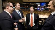 Ice Edge Holdings chairman Keith McCullough, second from right, laughs while joking with partners, from left to right, CEO Anthony LeBlanc, COO Daryl Jones, and CFO Todd Jordan in a suite at the ACC during NHL regular season action between the Phoenix Coyotes and Toronto Maple Leafs on December 16, 2009. (Darren Calabrese)