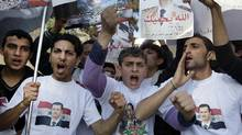 Protesters shout slogans as they carry pictures of Syrian President Bashar Assad and Syrian flags during a demonstration in front of the Russian Embassy in Beirut, Lebanon, Sunday, Jan. 29, 2012, to express gratitude for the Russian position in support of Syria. Russia has said it will use its Security Council veto to block any resolution threatening Syria with sanctions or lacking a clear ban on any foreign military interference. (Bilal Hussein/AP/Bilal Hussein/AP)