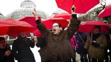 Chanelle Gallant raises her arms in celebration during a rally following the unanimous decision by Supreme Court of Canada which strikes down all three prostitution laws in Toronto on December 20, 2013. (Peter Power/The Globe and Mail)