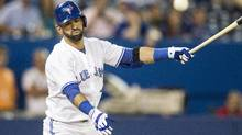 Toronto Blue Jays' Jose Bautista reacts as he hits a foul ball during ninth inning of his team's 14-6 loss to Oakland Athletics in AL baseball action in Toronto on Friday August 9, 2013. (CHRIS YOUNG/THE CANADIAN PRESS)