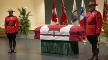 RCMP officers stand next to Jim Flaherty's casket during visitation at the Abilities Centre in Whitby, Ont., on Tuesday, April 15, 2014. (Frank Gunn/THE CANADIAN PRESS)