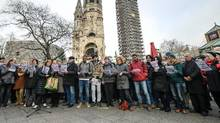 A choir of activists perform in front of the Kaiser Wilhelm Memorial Church on Wednesday. (CLEMENS BILAN/AFP)
