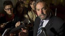 NDP leader Tom Mulcair speaks with the media in the Foyer of the Senate following caucus meetings on Parliament Hill Wednesday May 22, 2013 in Ottawa. (Adrian Wyld/THE CANADIAN PRESS)