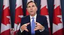 Finance Minister Bill Morneau holds a press conference at the National Press Theatre in Ottawa on Tuesday, July 18, 2017. Ottawa's fall parliamentary session is a couple of weeks away and Canadians are already getting a preview of what could be the season's main event: a scrap over the Liberals' proposed tax changes. THE CANADIAN PRESS/Sean Kilpatrick