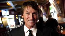 Wayne Gretzky poses in his restaurant in Toronto Thursday, September 9, 2010. (The Canadian Press)