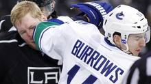 Vancouver Canucks' Alexandre Burrows (R) elbows Los Angeles Kings' Matt Greene in the face as the teams scuffle after Greene scored a goal during the second period of an NHL hockey game in Los Angeles December 31, 2011. REUTERS/Danny Moloshok (Danny Moloshok/Reuters)