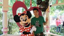 Lin Jun stands with Minnie Mouse at Hong Kong Disneyland in a photo shared by the murdered man's family. (HANDOUT/THE CANADIAN PRESS)