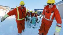 Linemen replace blown transformers as they attempt to return power to residential customers in St. John's on Jan. 6, 2014. (PAUL DALY/THE CANADIAN PRESS)