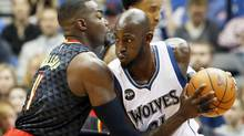 Minnesota Timberwolves forward Kevin Garnett is reportedly retiring after 21 seasons in the NBA. (Jim Mone/AP)