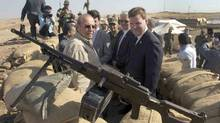 Canadian Foreign Affairs Minister John Baird, right, and Iraqi Deputy Minister Rowsch Nouri Sharways look at the ISIS positions from a front line bunker in Kalak, Iraq (Ryan Remiorz/The Canadian Press)
