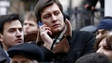 State Duma member Dmitry Gudkov, shown outside a Moscow court in February, could not bring himself to vote against Russia's annexation of Crimea. (Dzhavakhadze Zurab/Newscom)